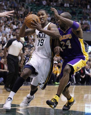 Raja Bell drives past Kobe Bryant during a game last season.