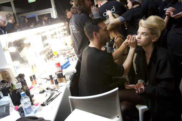A model has makeup applied backstage during London Fashion Week. Cosmetics tested on animals are now banned in the European Union.
