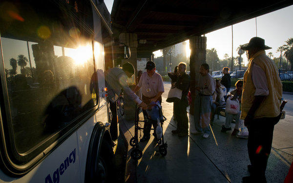 Americans took 10.5 billion trips on public transportation last year, 154 million trips more than 2011, a report said. Transit riders in Riverside board a bus.