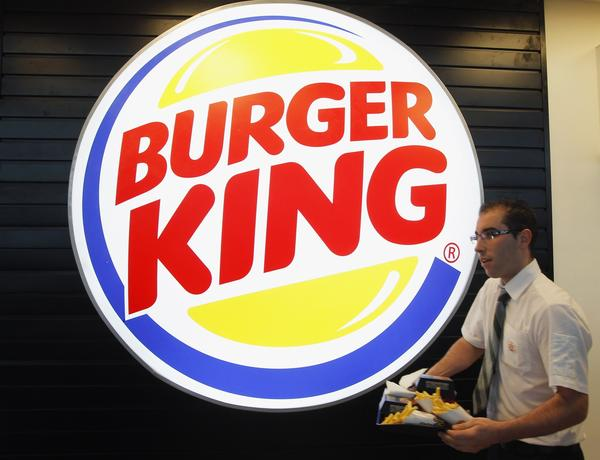 An employee prepares a food order on the opening day of the Burger King restaurant at the Marignane airport hall near Marseilles, France, in this December 22, 2012, file photo.