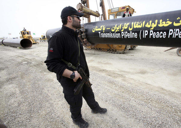 An Iranian security officer in Chabahar stands guard near the construction of a natural gas pipeline between Iran and Pakistan.