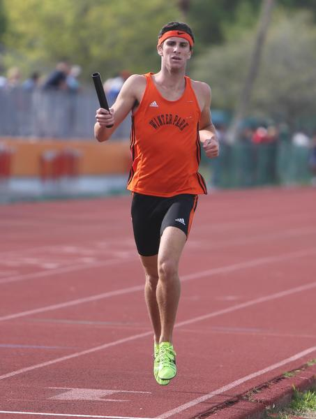Winter Park's John Lindsey runs the anchor leg of the  Distance Medley event at the 2013 Winter Park Wildcat Relays at Showalter Field in Winter Park, Florida on Saturday, March 9, 2013. Winter Park won the event with a time of 10:49.51.  (Cassie Armstrong, Orlando Sentinel)