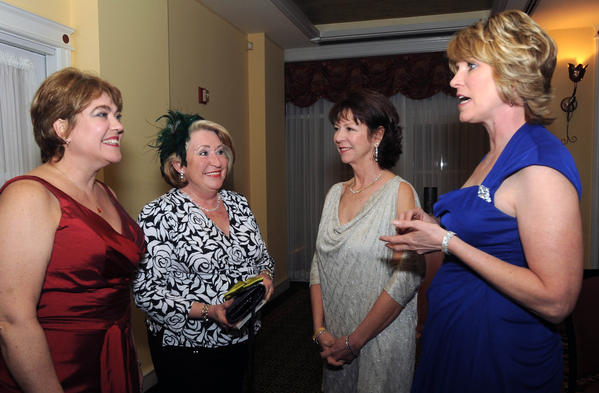 Diane Sengstacke, Marge Pearce, Nancy Worthington and June Thompson attended the Paint and Powder Club's annual President's Ball at Hayfield Country Club.