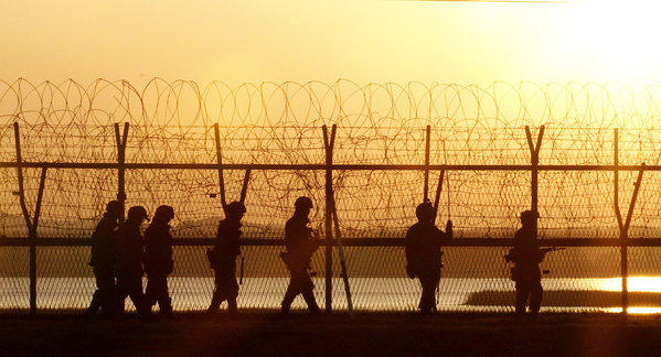 South Korean soldiers patrol along a fence near the border village of Panmunjom.