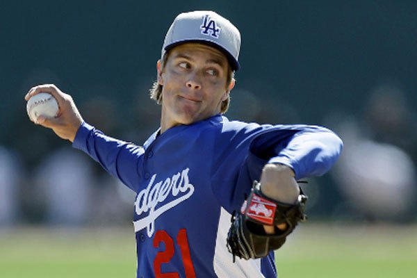 Right-hander Zack Greinke, the Dodgers' $147-million man, left spring training and headed to Los Angeles to have his tender elbow examined by Dr. Neal ElAttrache.