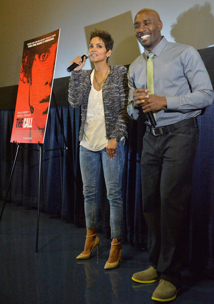 "MIAMI, FL - FEBRUARY 26:  Halle Berry and Morris Chestnut attend ""The Call"" red carpet screening hosted by the Woman's International Film Festival at Regal South Beach on February 26, 2013 in Miami, Florida.  (Photo by Gustavo Caballero/Getty Images)"