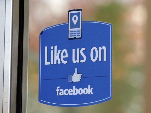 "A sign with Facebook's ""Like"" logo is posted at Facebook headquarters in Menlo Park, Calif."