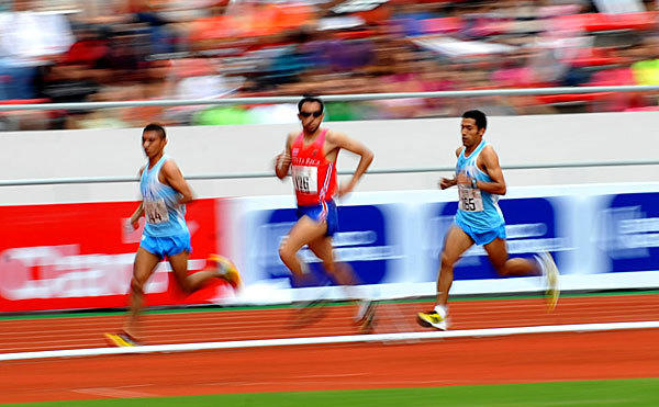 Runners from Costa Rica and Guatemala vie for first place during the 5000 Meters Men's race at the 10th Central American Games on March 10 in Costa Rica.