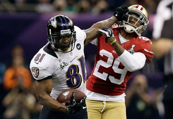 Baltimore receiver Anquan Boldin stiff-arms San Francisco's Chris Culliver during the Super Bowl.