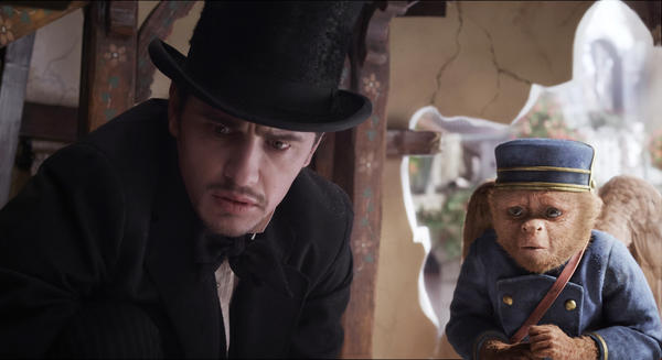 "This film image released by Disney Enterprises shows James Franco, as Oz, left, and the character Finley, voiced by Zach Braff, are shown in a scene from ""Oz the Great and Powerful."""