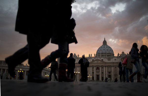 People walk outside St. Peter's Square at the Vatican.