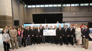 The 2013 Chicago Auto Show served as a backdrop for a Chicagoland Dealers Care check presentation held on the last day of the public show on February 18. The Chicago Automobile Trade Association (CATA) donated $8,000 to 16 local charitable organizations, nominated by Chicagoland dealerships, as a part of the Chicagoland Dealers Care program.
