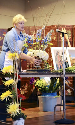 In this March 31, 2012, file photo, Sylvia Deck, a National Garden Club-accredited judge, gives a floral demonstration at the 10th annual Art in Bloom at the Washington County Museum of Fine Arts.