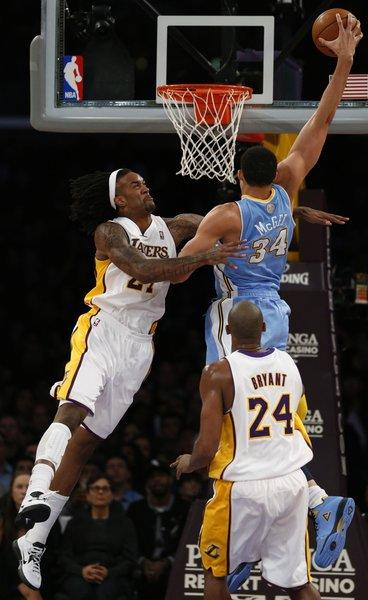 Nuggets center JaVale McGee tries to dunk over Jordan Hill during the game in which Hill was injured.