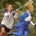 F. Scott Key's Mindy Deslatte (left) sneaks up on Southern's Jessica Wolf
