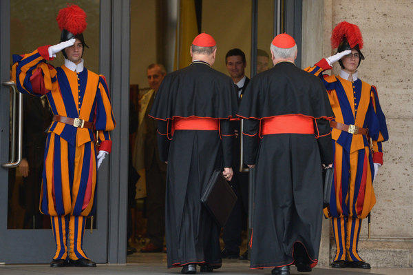 Cardinals arrive for the final congregation before they enter the conclave to vote for a new pope.