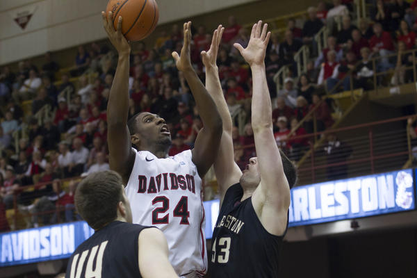 Davidson Wildcats forward De'Mon Brooks (24) shoots the ball over Charleston Cougars forward Willis Hall (53) during the first half in the championship game of the Southern Conference Tournament at US Cellular Center.