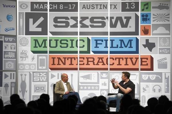 Elon Musk, right, the founder of Space Exploration Technologies and Tesla Motors, engages in a discussion with Chris Anderson, co-founder of 3D Robotics, at the South by Southwest Interative conference in Austin, Texas.