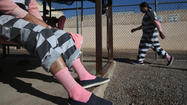 Inmates live in tents, wear pink underwear