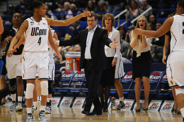 Connecticut coach Geno Auriemma greets his players after they went on a bit of a run, forcing a Syracuse timeout during the first half.