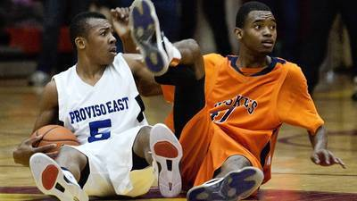 Jevon Carter (5) of Proviso East and Oak Park's TK Mattox both wait for a foul to be called after fighting for a loose ball on March 8, 2013.