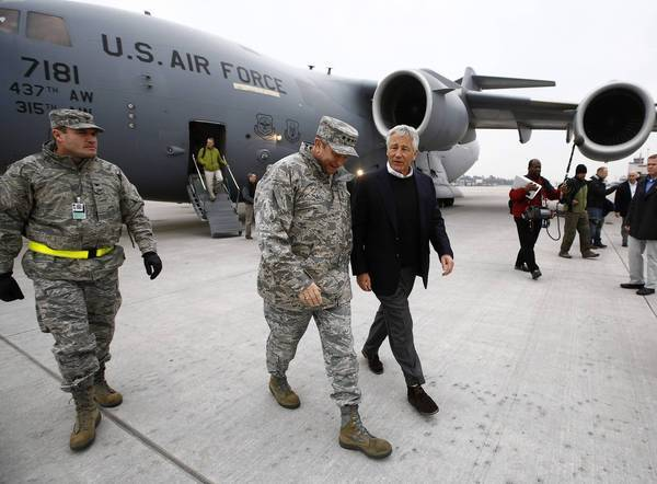 Defense Secretary Chuck Hagel, right, arrives in Germany on Monday.