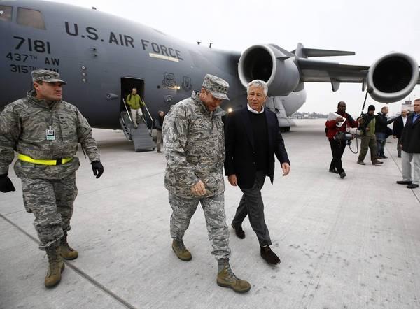 Defense Secretary Chuck Hagel, right, arrives in Germany on Monday.