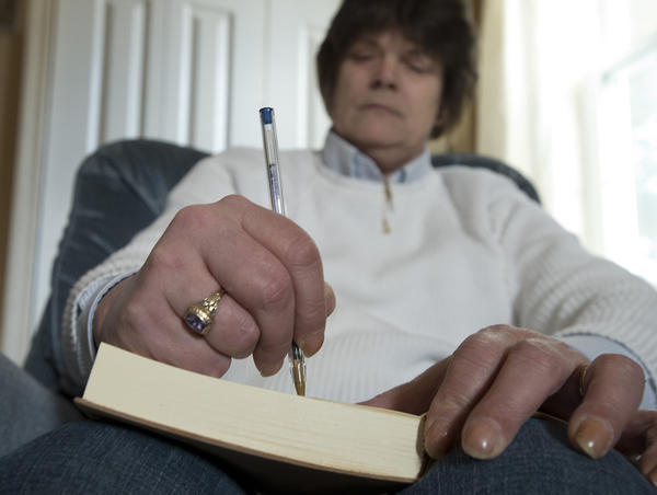 "Traci Rumsey writes in her journal inside her Bangor home on Thursday, February 28, 2013. Rumsey, who has had a difficult time coping with bipolar disorder,  shares her insight on the condition in her book. ""You don't have to like it."""