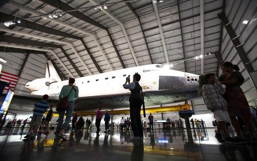 Visitors view the space shuttle Endeavour at the California Science Center. More than 1 million people have visited since Endeavour made its debut just over four months ago, far surpassing officials' expectations for the Exposition Park museum.