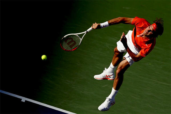 Roger Federer serves to Ivan Dodig of Croatia during the BNP Paribas Open at the Indian Wells.