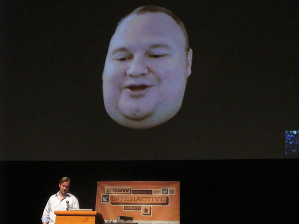 Megaupload founder Kim Dotcom appears via Skype video link from New Zealand, with journalist Charles Graeber on the stage below him, during the South by Southwest festival. Dotcom explained his fight against extradition to the United States, which alleges that Megaupload cost the U.S. movie industry millions of dollars.