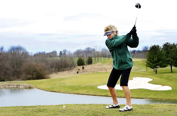 Sandy Murphy of Hollidaysburg, Pa., hits from the 15th tee at Black Rock Golf Course on Monday afternoon. Murphy and her husband came to the area to ski but took advantage of the warm weather and decided to play golf.