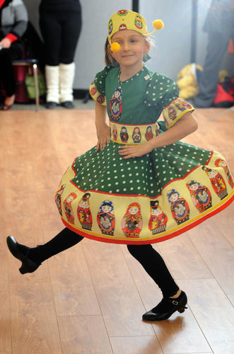 Natasha Kravchenko, 8, of Pikesville, practices a dance with Kalinka Russian  Dance Ensemble of Baltimore children's group dancers.
