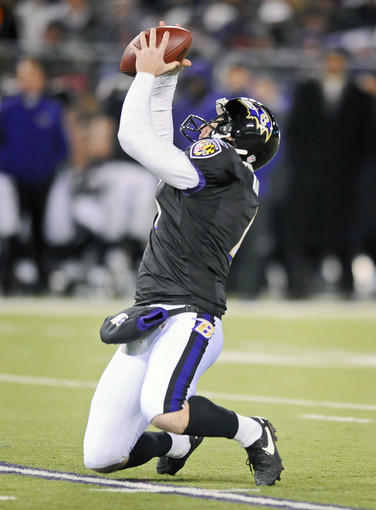 Ravens holder Sam Koch catches a high snap on a field-goal attempt in ...