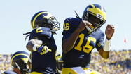 Former Michigan quarterback Denard Robinson won a spot on the next EA Sports NCAA Football 13 video game.