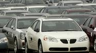 The National Highway Traffic Safety Administration is investigating whether to add more than a million General Motors mid-size cars to a 2009 recall for brake light problems.
