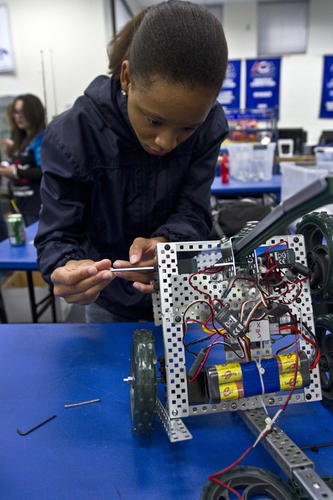 N.H.students Shawmonique Ferguson 19 is making some repairs on their robot after a field test game...Dutch students are visiting the New Horizons Regional Education Center in Hampton today as part of an ongoing robot-building project. In 2010 New Horizons students won several awards for robot competitions.  Both teams have built new robots that are ready to compete in North Carolina next weekend.
