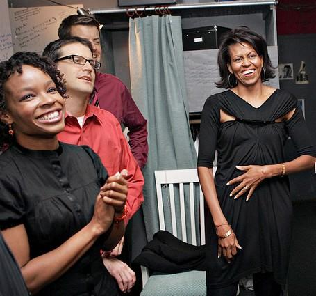 "Michelle Obama meets with cast members of the Second City comedy troupe's show, ""Between Barack and a Hard Place,"" at the Second City Theatre in Chicago after a performance last July. The ascent of Barack Obama was a focal point of the comedy routine."