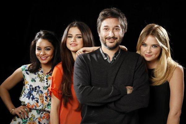 "Director Harmony Korine poses for a portrait with three of his four lead actresses from his new film ""Spring Breakers"" at the SLS hotel. Left to right, Vanessa Hudgens, Selena Gomez and Ashley Benson."