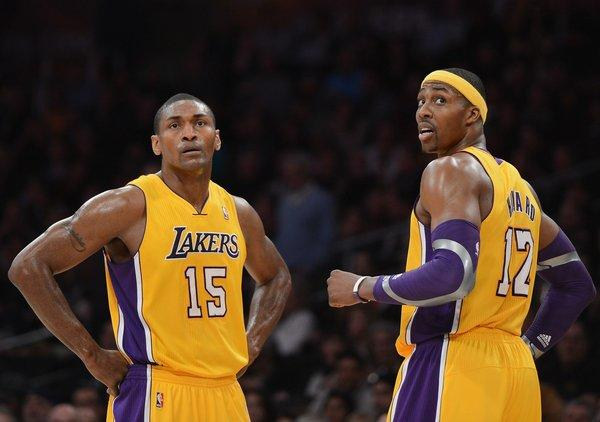 Metta World Peace, left, was an unexpected guest during Lakers teammate Dwight Howard's media session Tuesday morning in Orlando.