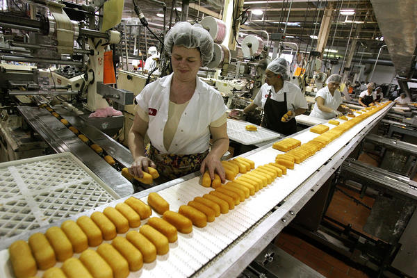 Workers prepare Twinkies for packaging at a Schiller Park plant in 2005. The Twinkie, one of America's best-known snack treats, was created in Chicagoland by James Dewar in 1930.