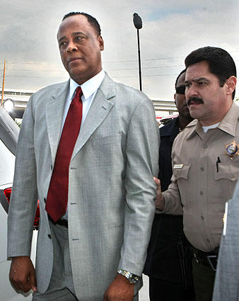 Dr. Conrad Murray, the physician who was with Michael Jackson at the time of  the music legend's death in 2009, is escorted by a law enforcement officer into the Airport Courthouse in Los Angeles. Murray is now serving time for involuntary manslaughter.