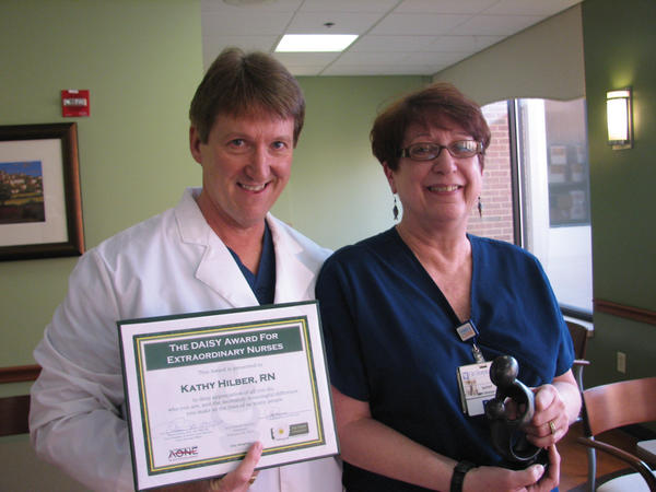 Kathy Hilber, RN, receives the DAISY Award for Extraordinary Nurses from Steve Folmer, director of surgical services.