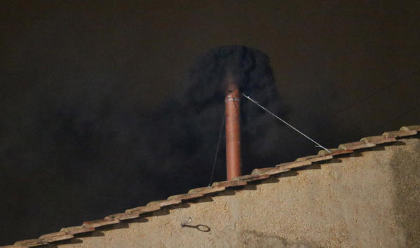 Black smoke billows out from a chimney on the roof of the Sistine Chapel indicating that the College of Cardinals have failed to elect a new Pope today. Pope Benedict XVI's successor is being chosen by the College of Cardinals in Conclave in the Sistine Chapel. The 115 cardinal-electors, meeting in strict secrecy, will need to reach a two-thirds-plus-one vote majority to elect the 266th Pontiff.