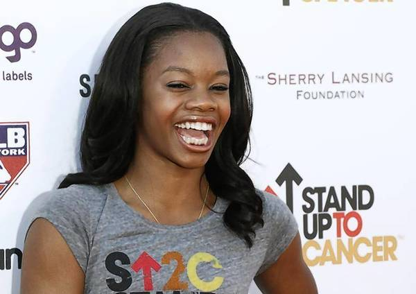 Olympic gold medal gymnast Gabrielle Douglas arrives for the Stand Up To Cancer telethon in Los Angeles, Calif.