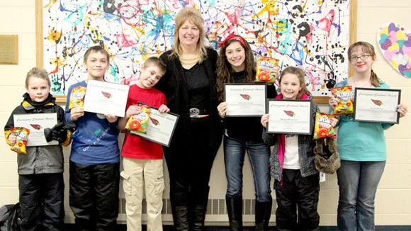 "Some of J-L School's outstanding young citizens: ""Courageous Cardinals"" Alex Mackowiak, Trey Krovchuck, Danny Mackowiak, bus driver Renee Campbell, Haley McVannel, Morgan McVannel and Sarah Morey."