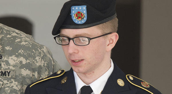Bradley Manning is escorted by military police as he departs the courtroom at Fort Meade, Md., in this file photo.