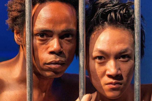"R.J. Jones and Megan Kim portray the Caged Man and the Caged Woman in City Garage's world premiere of Charles A. Duncombe's ""Caged."""