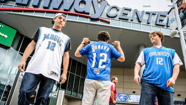Magic fans left to right, Keaton Palmer, Marc Craen, and Jason Allen wear self modified Dwight Howard shirts before the start of a game against the Los Angeles Lakers at Amway Center in Orlando, Fla. on Tuesday, March 12, 2013. (Joshua C. Cruey/Orlando Sentinel)
