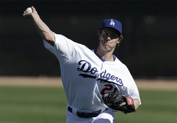 Dodgers starting pitcher Zack Greinke throws during spring training.